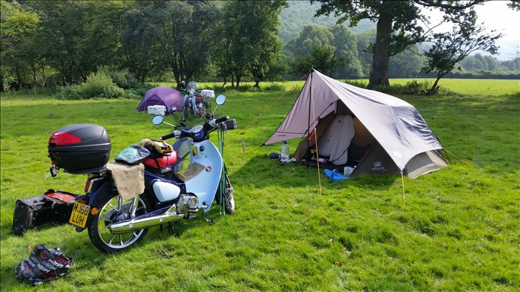 The Honda Cub 125 and Bogger's tent in a pleasant field in Wales