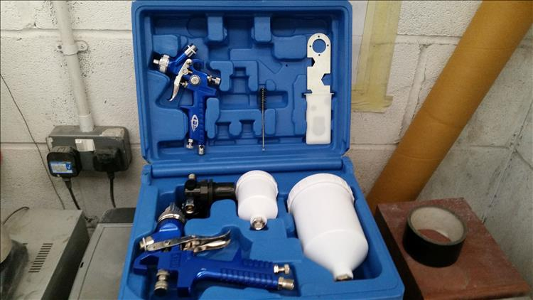 The cheap spray kit. In a moulded box with bottles, guns and tools