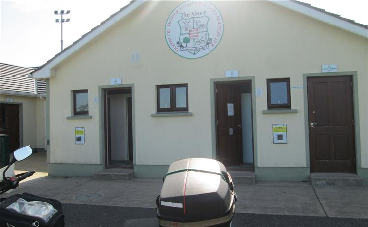 A smart white building with the doors to the toilets open at Derrylaughan