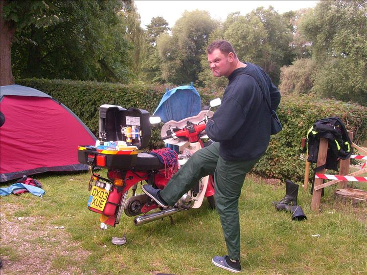 Pete, a big solid tall chap, pretends to kick the C90 and looks most disgruntled