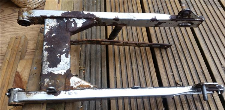The top side of the swing arm is also rusty and lots of paint has flaked off