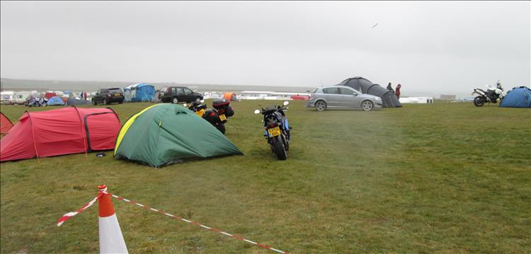 motorcycles and tents in the wind and the rain