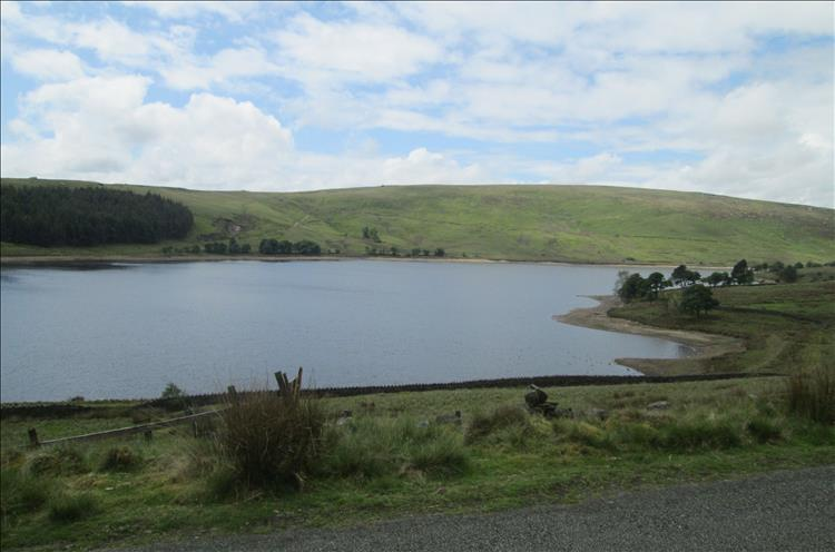 A reservoir set among the the green hills and  valleys south of Burnely