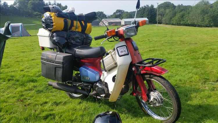 C90 honda with a full load of bags, boxes and bungees