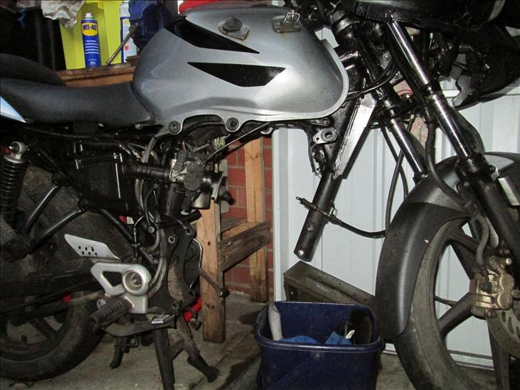 Ren's CBF125 without the engine in place, showing a space where an electric motor could be