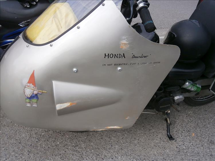 The huge ally streamliner fairing has several scores and scratches along one side
