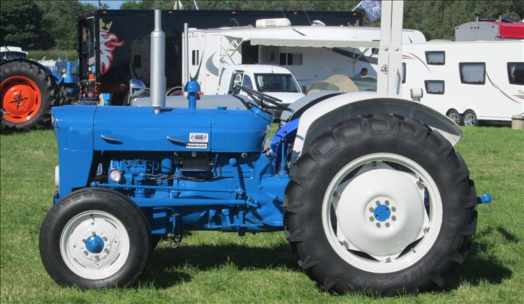 A vintage tractor looking smart and new in blue