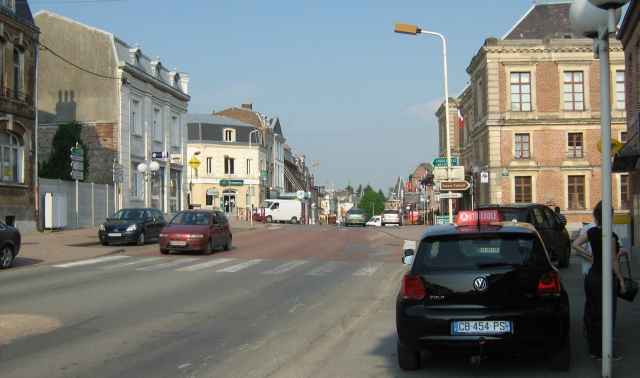 le nouvion-en-thierache town centre, a small french town centre with a few cars and people