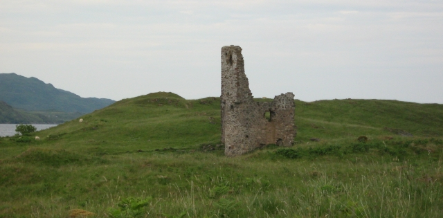ardvrek castle ruins, just part of a tower and wall among grassy hills