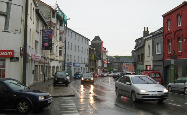 a street in bastogne in the rain