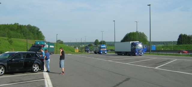 a large car park, empty save for a few cars and lorries