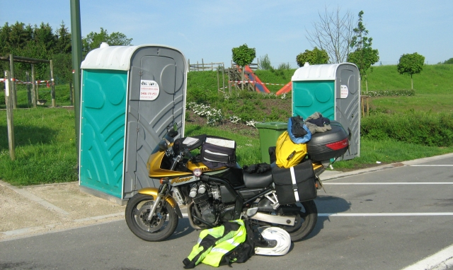 2 portaloos and a playground on what might be called belgium services