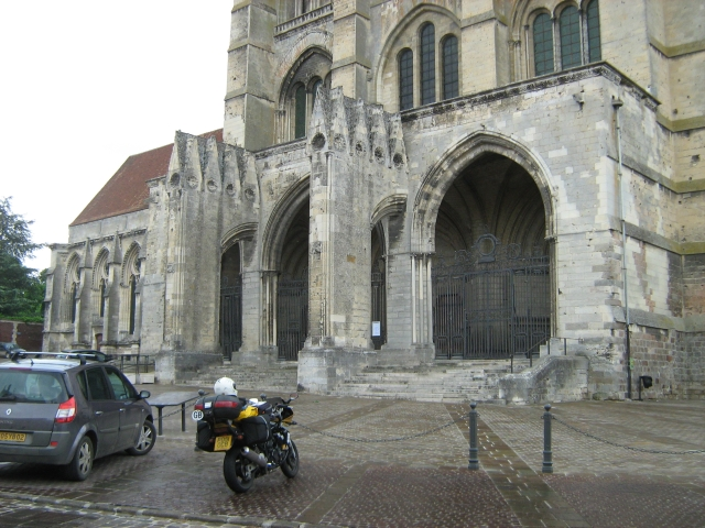 my bike outside a large imposing church in france