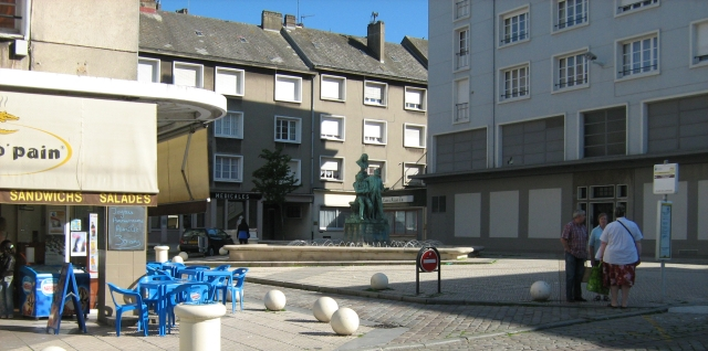 3 elderly people stand in an otherwise empty square in boulogne