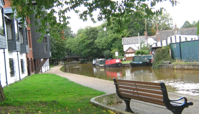 a canal next to smart houses and plenty of trees in worsley