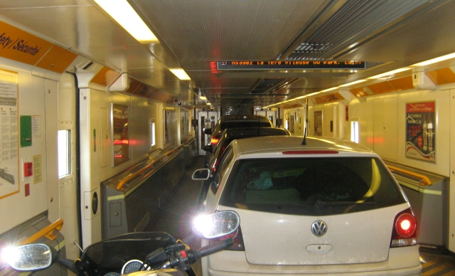 cars in a row along the chunnel train carriage
