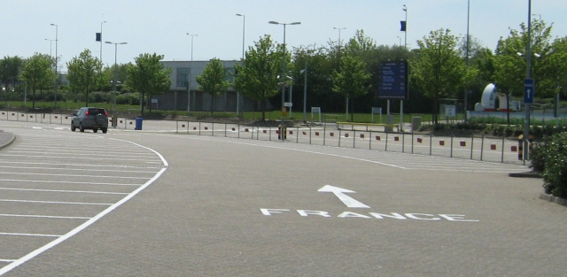 car park with france painted in white on the floor