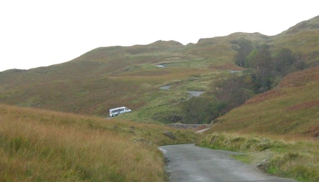 A minibus struggles up the steep slopes of the Hardknott Pass