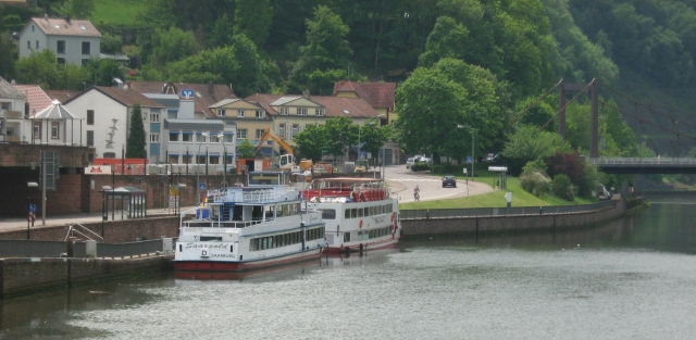 2 pleasure cruise boats on a big river at mettlach germany