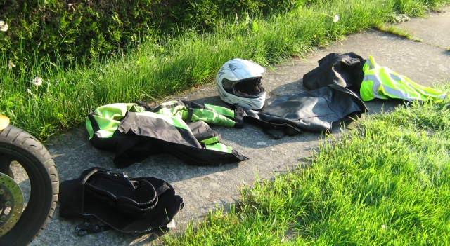 my motorcycle clothing on the concrete footpath at the campsite in bastogne, drying out in the sun