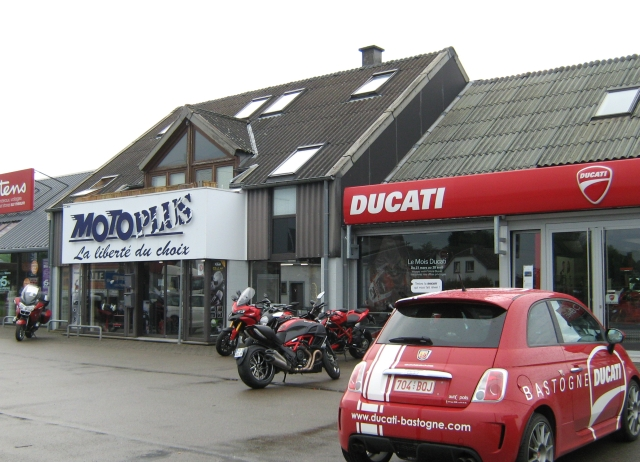 a ducati and motorcycle clothing shop in bastogne in the rain