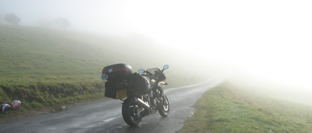 yamaha fazer 600 with luggage in the mist on a hillside