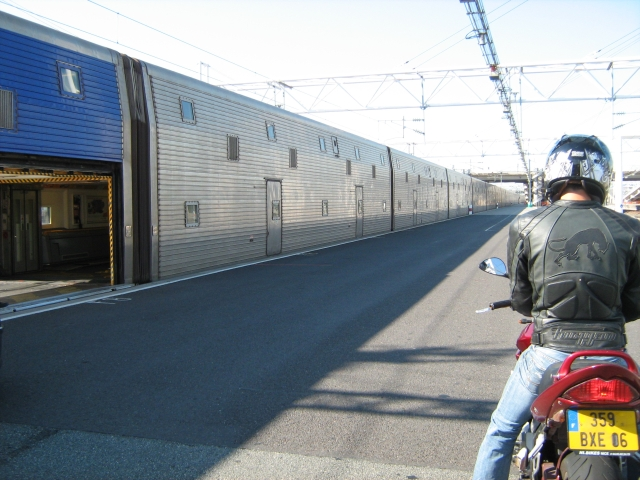 rear end of a motorcycle with large channel tunnel carriages one with an entrance open