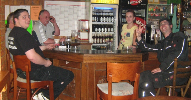 4 men ad a young bar gilr in a bar at lebach