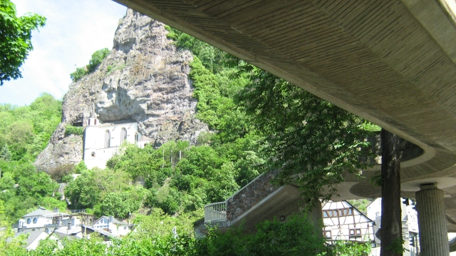 the church in the rock at idar oberstein, also showing a large concrete overpass