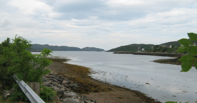 lochinver seen from lochinver village.  A broad stretch of water with hills all around