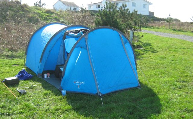 my blue vango tunnel tent in the sunshine on a campsite