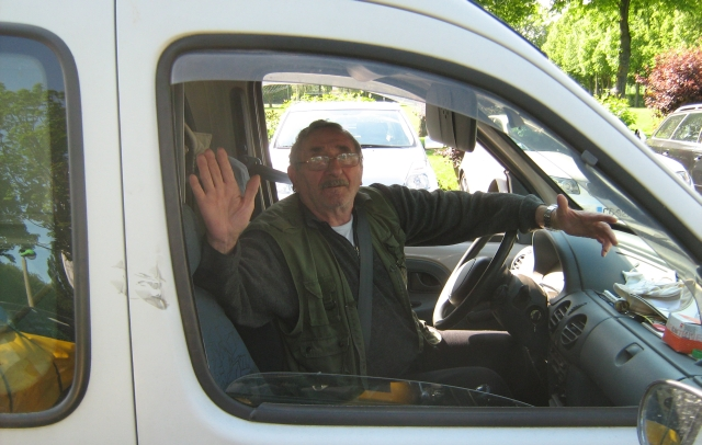 the elderly gentleman sat in his white van, waving his goodbye to me