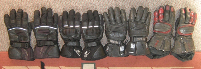 4 pairs of motorcycle gloves in a liine