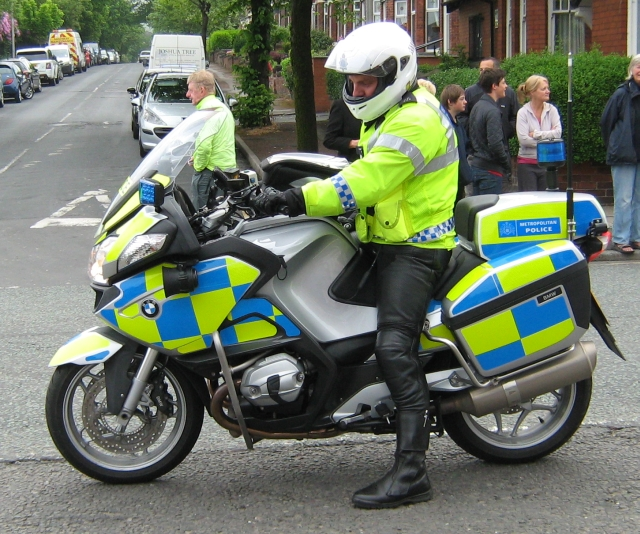 a policeman on his bmw police motorcycle
