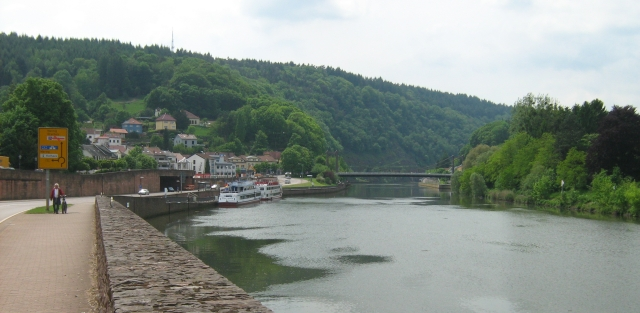 mettlach germany with the river flowing between the valley walls and pleasure craft in the water