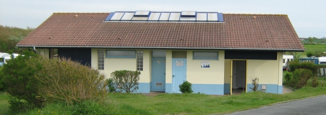a long low building that is the shower block at the campsite in wimeraux, france