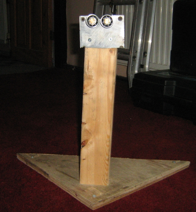 the plate with the bearings on mounted to a pice of wood upright on a flat board