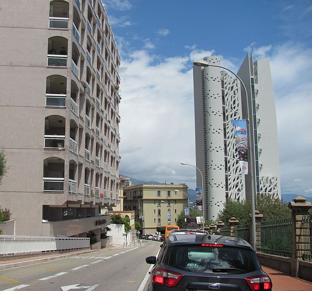 concrete apartments and trendy tall buildings and a line of traffic in Monaco
