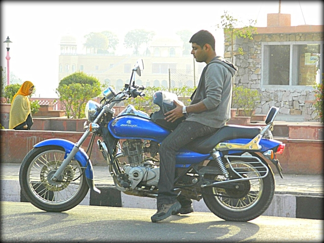 arjun sat on his bajaj avenger in the sun