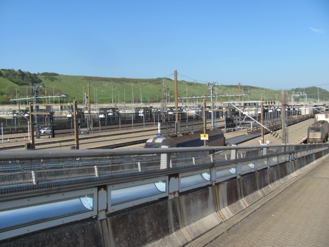 the ramp to the channel tunnel trains. lots of overhead power lines and platforms