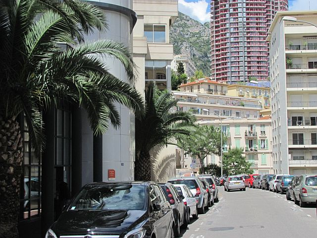 narrow cramped streets with cars parked either side amidst tall cramped buildings in monaco