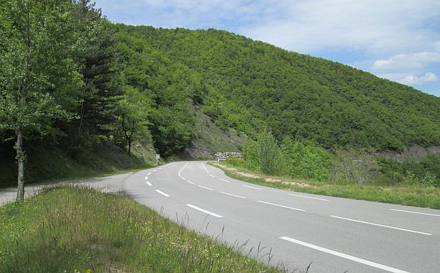 tree covered hills and twisting road winding through it on the d999