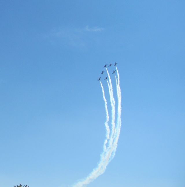 7 jets making smoke trails very high in the blue skies at salon de provence