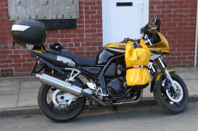 fazer 600 with front bags in bright yellow either side of the engine