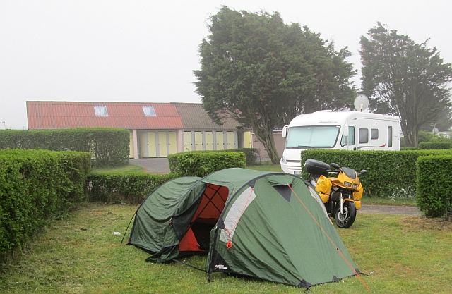 the fazer with side bags and the tent under a grey sky in the rain
