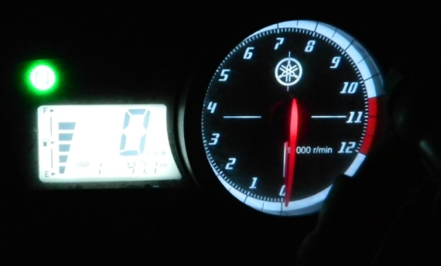 motorcycle clocks shining in the dark night