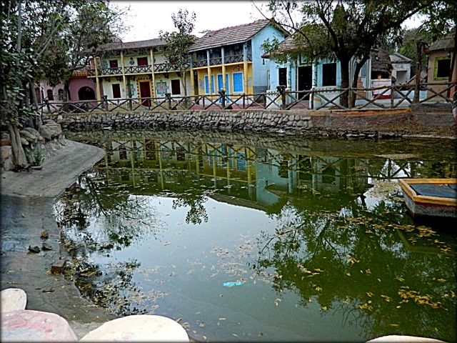 indian houses around a pond