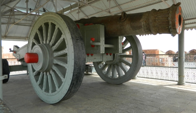 large old canon on wooden wheels