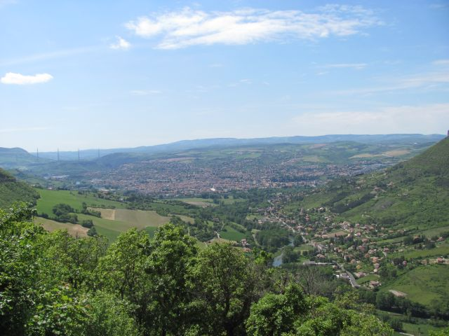 millau sits on the valley floor with the viaduct in the hazy far distance