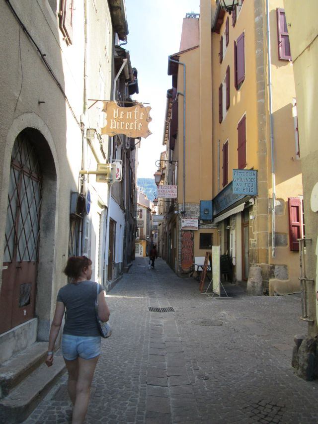 the gf walking down a narrow typically french street